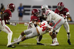Ohio State running back Marcus Crowley is tackled by Alabama during the second half of an NCAA College Football Playoff national championship game, Monday, Jan. 11, 2021, in Miami Gardens, Fla. (AP Photo/Chris O'Meara)