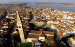 This image taken on Thursday, Jan. 16, 2020, shows an overview of the Burano island, Italy. The Venetian island of Burano's legacy as a fishing village remains the source of its charms: the small colorful fishermen's cottages, traditional butter cookies that were the fishermen's sustenance at sea and delicate lace still stitched by women in their homes. As the island's population dwindles, echoing that of Venice itself, so too are the numbers of skilled artisans and tradespeople who have kept the traditions and economy alive. (AP Photo/Luca Bruno)