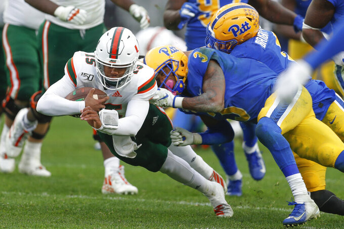 Miami quarterback Jarren Williams (15) dives for a first down past Pittsburgh defensive back Damar Hamlin (3) during the second half of an NCAA college football game, Saturday, Oct. 26, 2019, in Pittsburgh. Miami won 16-12. (AP Photo/Keith Srakocic)