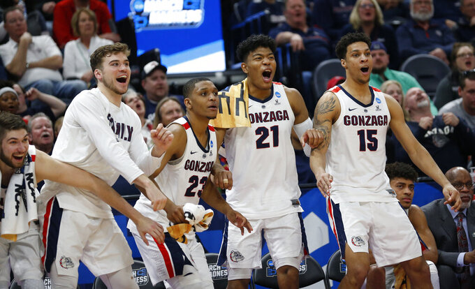 Gonzaga's bench celebrates during the second half against Fairleigh Dickinson during a first-round game in the NCAA men's college basketball tournament Thursday, March 21, 2019, in Salt Lake City. (AP Photo/Rick Bowmer)