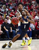 Akron guard Loren Cristian Jackson (1) is fouled by Louisville guard David Johnson, top, during the first half of an NCAA college basketball game in Louisville, Ky., Sunday, Nov. 24, 2019. (AP Photo/Timothy D. Easley)