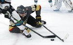 Vegas Golden Knights right wing Alex Tuch (89) falls to the ice during the second period of the team's NHL hockey game against the San Jose Sharks on Thursday, Nov. 21, 2019, in Las Vegas. (AP Photo/John Locher)