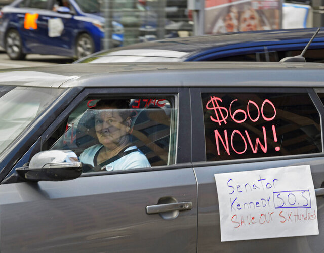 Motorists take part in a caravan protest in front of Senator John Kennedy's office at the Hale Boggs Federal Building asking for the extension of the $600 in unemployment benefits to people out of work because of the coronavirus in New Orleans, La. Wednesday, July 22, 2020. (Max Becherer/The Advocate via AP)