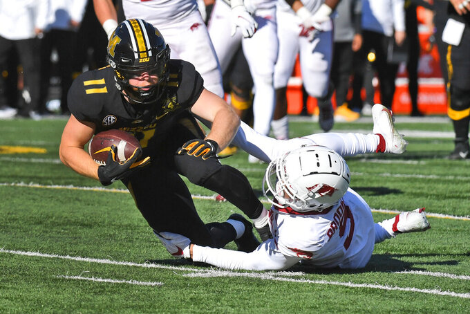 Missouri wide receiver Barrett Banister is tackled by Arkansas defensive back Greg Brooks Jr. during the first half of an NCAA college football game Saturday, Dec. 5, 2020, in Columbia, Mo. (AP Photo/L.G. Patterson)