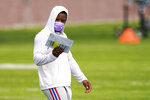 New York Giants running back Saquon Barkley studies a chart at NFL football training camp, Wednesday, July 28, 2021, in East Rutherford, N.J. (AP Photo/Corey Sipkin)