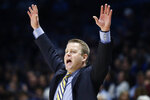 Marquette coach Steve Wojciechowski gestures to players during the second half of the team's NCAA college basketball game against Xavier, Wednesday, Jan. 29, 2020, in Cincinnati. (AP Photo/John Minchillo)