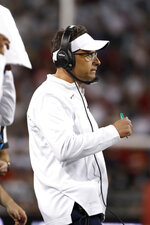 Arizona coach Jedd Fisch watches the first half of the team's NCAA college football game against UCLA on Saturday, Oct. 9, 2021, in Tucson, Ariz. (AP Photo/Chris Coduto)