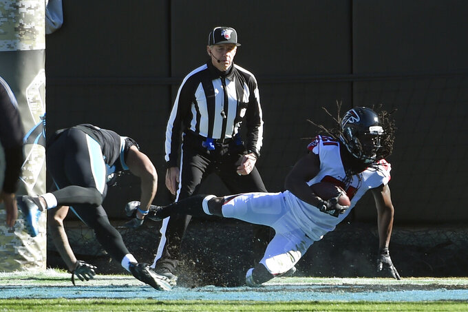 Atlanta Falcons cornerback Desmond Trufant (21) intercepts a pass in the end zone during the first half of an NFL football game against the Carolina Panthers in Charlotte, N.C., Sunday, Nov. 17, 2019. (AP Photo/Mike McCarn)