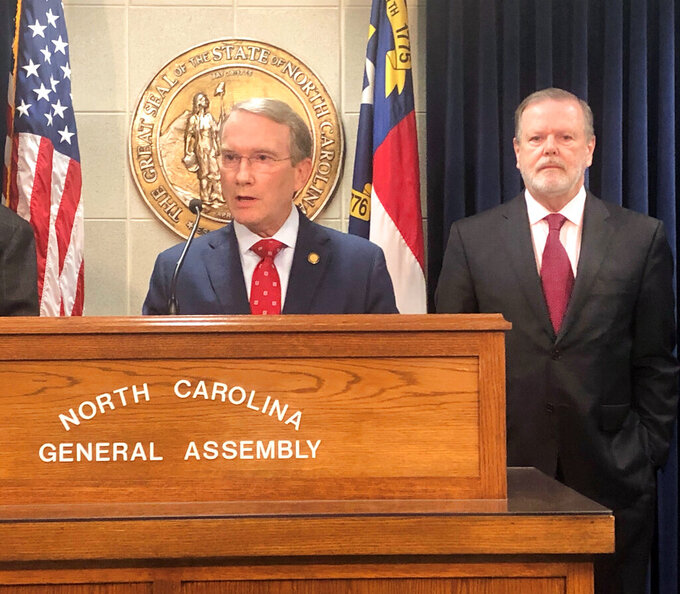 North Carolina state Sen. Paul Newton, R-Cabarrus, center, speaks while Senate leader Phil Berger, R-Rockingham listens at a Legislative Building news conference on Wednesday, June, 2, 2021, in Raleigh, N.C. Newton explained why Republicans have decided to oppose the confirmation of Dionne Delli-Gatti as secretary of the North Carolina Department of Environmental Quality. (AP Photo/Gary D. Robertson)