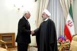 In this photo released by the official website of the Office of the Iranian Presidency, President Hassan Rouhani, right, welcomes European Union foreign policy chief Josep Borrell for their meeting in Tehran, Iran, Monday, Feb. 3, 2020. (Office of the Iranian Presidency via AP)