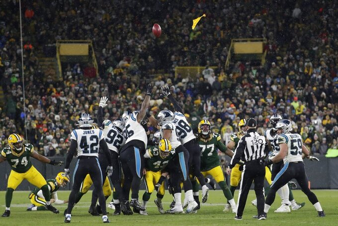The Carolina Panthers are called for a penalty as the Green Bay Packers attempt a field goal during the second half of an NFL football game Sunday, Nov. 10, 2019, in Green Bay, Wis. (AP Photo/Morry Gash)