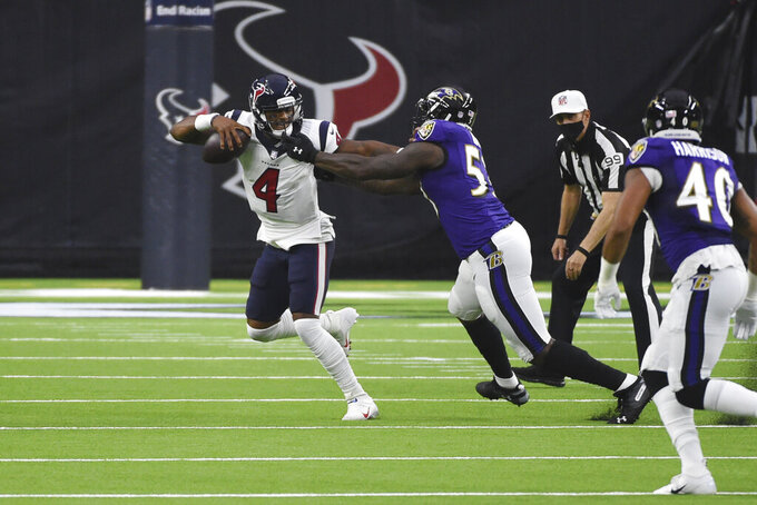 Houston Texans quarterback Deshaun Watson (4) is pressured by Baltimore Ravens defensive end Jihad Ward (53) during the first half of an NFL football game Sunday, Sept. 20, 2020, in Houston. (AP Photo/Eric Christian Smith)