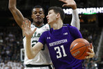 Northwestern forward Robbie Beran (31) attempts a layup as Michigan State forward Xavier Tillman (23) defends during the first half of an NCAA college basketball game, Wednesday, Jan. 29, 2020, in East Lansing, Mich. (AP Photo/Carlos Osorio)