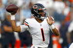 Chicago Bears quarterback Justin Fields plays against the Tennessee Titans in the first half of a preseason NFL football game Saturday, Aug. 28, 2021, in Nashville, Tenn. (AP Photo/Wade Payne)