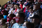 Supporters of President Donald Trump listen as he speaks at a campaign rally, Friday, Sept. 25, 2020, in Newport News, Va. (AP Photo/Evan Vucci)