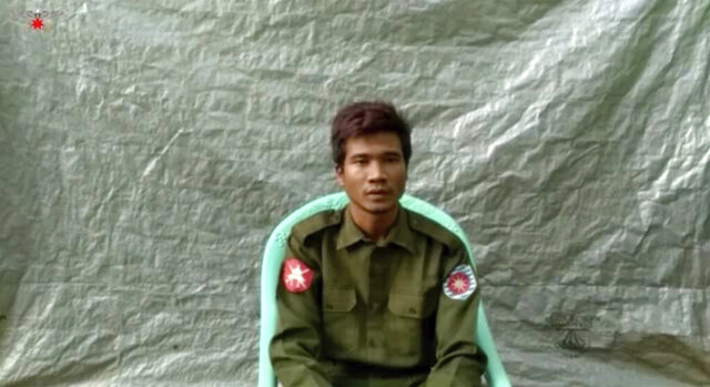 "In this image taken from video provided by the Arakan Army, Private Zaw Naing Tun provides a video testimony from an undisclosed location somewhere in Myanmar on July 8, 2020. Two soldiers who deserted from Myanmar's army have testified on video that they were instructed by commanding officers to ""shoot all that you see and that you hear"" in villages where minority Rohingya Muslims lived, a human rights group said Tuesday, Sept. 8, 2020. (Arakan Army via AP)"