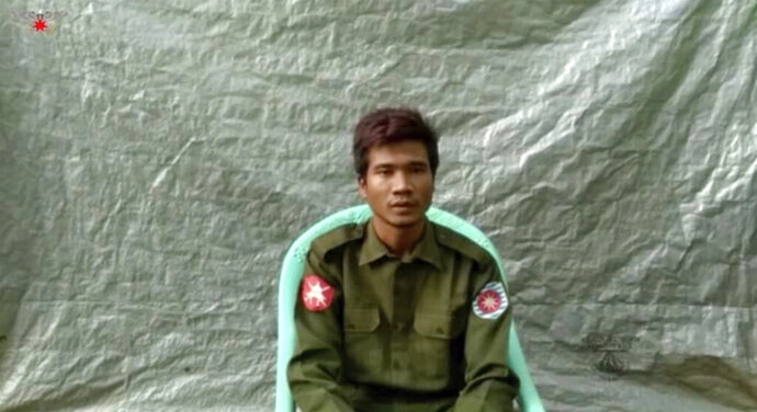 """In this image taken from video provided by the Arakan Army, Private Zaw Naing Tun provides a video testimony from an undisclosed location somewhere in Myanmar on July 8, 2020. Two soldiers who deserted from Myanmar's army have testified on video that they were instructed by commanding officers to """"shoot all that you see and that you hear"""" in villages where minority Rohingya Muslims lived, a human rights group said Tuesday, Sept. 8, 2020. (Arakan Army via AP)"""