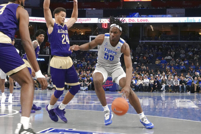 Memphis' Precious Achiuwa (55) drives the ball past Alcorn State Arne Morris (24) in the second half of an NCAA college basketball game Saturday, Nov. 16, 2019, in Memphis, Tenn. (AP Photo/Karen Pulfer Focht)