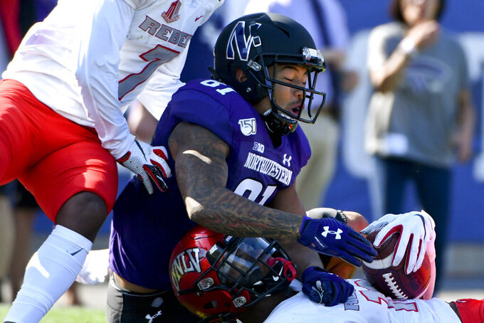 UNLV linebacker Javin White, right, intercepts a pass meant for Northwestern wide receiver Ramaud Chiaokhiao-Bowman (81) during the first half of an NCAA college football game, Saturday, Sept. 14, 2019, in Evanston, Ill. (AP Photo/Matt Marton)