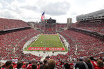 FILE - In this Sept. 21, 2013, file photo, Ohio State plays against Florida A&M at Ohio Stadium during an NCAA college football game in Columbus, Ohio. What is most commonly referred to as major college football (aka NCAA Division I Bowl Subdivision or FBS) is compromised of 130 teams and 10 conferences. Seventy-seven of those teams are scheduled to play throughout the fall, starting at various times in September. The other 53, including the entire Big Ten and Pac-12, have postponed their seasons and are hoping to make them up later. That means no No. 2 Ohio State, No. 7 Penn State, No. 9 Oregon and six other teams that were ranked in the preseason AP Top 25. (AP Photo/Jay LaPrete, File)