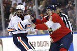 Edmonton Oilers left wing Jujhar Khaira (16) and Florida Panthers defenseman Josh Brown (2) fight during the second period of an NHL hockey game, Saturday, Feb. 15, 2020, in Sunrise, Fla. (AP Photo/Lynne Sladky)