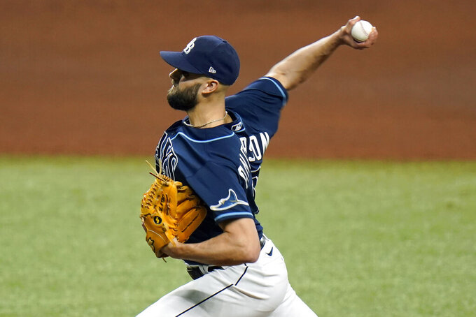 Tampa Bay Rays relief pitcher Nick Anderson delivers to the Toronto Blue Jays during the seventh inning of Game 1 of a wild card series playoff baseball game Tuesday, Sept. 29, 2020, in St. Petersburg, Fla. (AP Photo/Chris O'Meara)