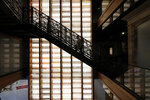 A person walks up the stairs from the second to the third level during a media preview for the Sazerac house, in New Orleans, Tuesday, Sept. 10, 2019. Visitors to New Orleans who want to learn more about cocktails will soon have a new place to go. No, it's not another bar. The Sazerac House is a six-story building on the city's famed Canal Street owned by the Sazerac Company, a Louisiana-based spirits maker, featuring the signature New Orleans drink called the Sazerac. Tasting is encouraged, and in addition to free samples given to visitors, there will also be special classes and tastings offered daily. (AP Photo/Gerald Herbert)