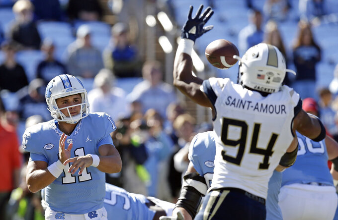 FILE - In this Saturday, Nov. 3, 2018, file photo, North Carolina quarterback Nathan Elliott (11) has a pass blocked by Georgia Tech's Anree Saint-Amour (94) during the first half of an NCAA college football game in Chapel Hill, N.C. Saint-Amour, coming off a big game in a win over North Carolina, is a big reason the Yellow Jackets rank among the nation's leaders in turnovers forced as they prepare to play Miami on Saturday. (AP Photo/Gerry Broome, File)