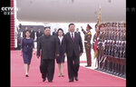 In this image taken from a video footage run by China's CCTV, North Korean leader Kim Jong Un, left, and Chinese President Xi Jinping, right, walk together on Xi's arrival at an airport in Pyongyang, North Korea, Thursday, June 20, 2019. The leaders of China and North Korea met in the North's capital on Thursday, their fifth meeting in 15 months, with stalled nuclear negotiations with Washington expected to be on the agenda. (CCTV via AP)