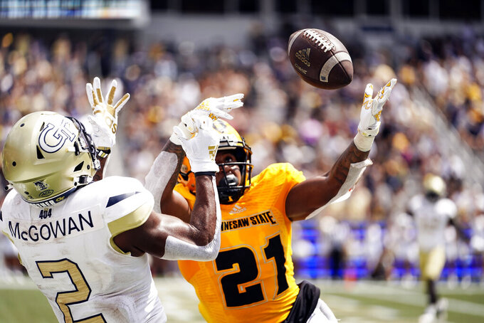 Kennesaw State defensive back Markeith Montgomery (21) defends against Georgia Tech wide receiver Kyric McGowan (2)  during the first half of an NCAA college football game, Saturday, Sept. 11, 2021, in Atlanta. (AP Photo/Brynn Anderson)