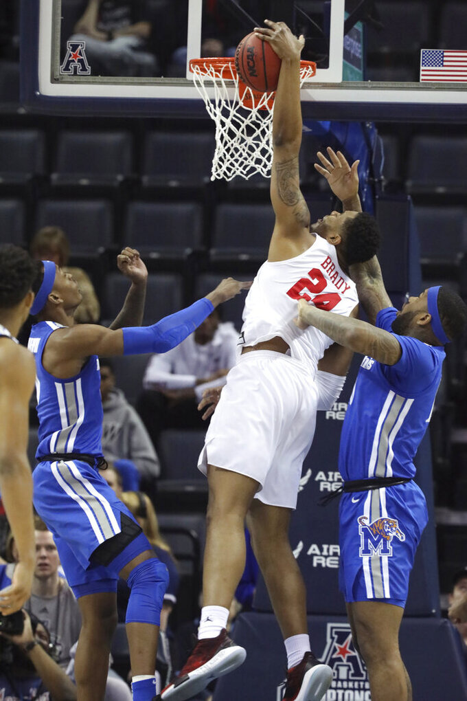 Memphis players Kevin Davenport, left, and Mike Parks fight for a rebound against Houston's Breaon Brady in the first half of an NCAA college basketball game at the American Athletic Conference tournament Saturday, March 16, 2019, in Memphis, Tenn. (AP Photo/Troy Glasgow)