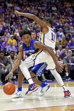 Kentucky guard Ashton Hagans (0) attempts to go around LSU guard Charles Manning Jr. (11) while driving to the basket during the first half of an NCAA college basketball game Tuesday, Feb. 18, 2020, in Baton Rouge, La. (AP Photo/Bill Feig)