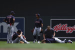 Cleveland Indians' Josh Naylor (22) lies on the ground with a member from the Indians medical staff after colliding with teammate Ernie Clement to catch a ball during the fourth inning of a baseball game against the Minnesota Twins, Sunday, June 27, 2021, in Minneapolis. (AP Photo/Stacy Bengs)