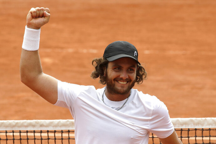 FILE - In this May 28, 2018 file photo, Argentina's Marco Trungelliti riases his fist after defeating Australia's Bernard Tomic during their first round match of the French Open tennis tournament at the Roland Garros stadium in Paris. Blowing the whistle on betting-related corruption that is eating at tennis' credibility has come at a cost for the Argentine whose mad-dash road trip to Roland Garros last year caused a sensation. (AP Photo/Alessandra Tarantino, File)