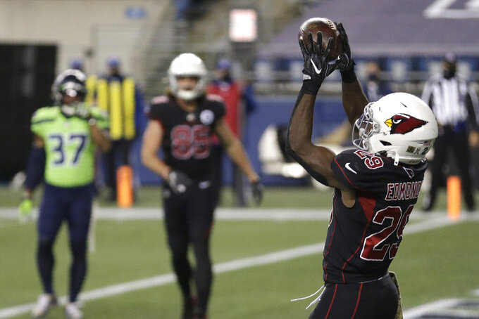 Arizona Cardinals running back Chase Edmonds, right, catches a pass against the Seattle Seahawks for a touchdown during the second half of an NFL football game, Thursday, Nov. 19, 2020, in Seattle. (AP Photo/Lindsey Wasson)