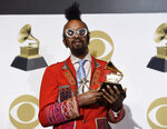 Fantastic Negrito poses in the press room with the award for best contemporary blues album for