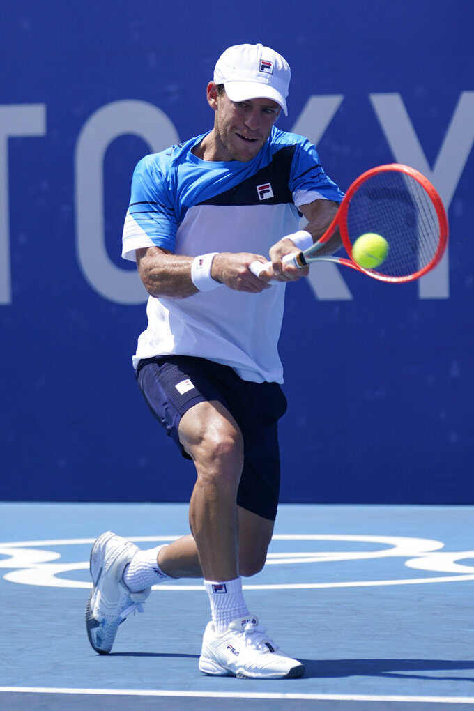 Diego Schwartzman, of Argentina, plays Karen Khachanov, of the Russian Olympic Committee, during the third round of the tennis competition at the 2020 Summer Olympics, Wednesday, July 28, 2021, in Tokyo, Japan. (AP Photo/Seth Wenig)