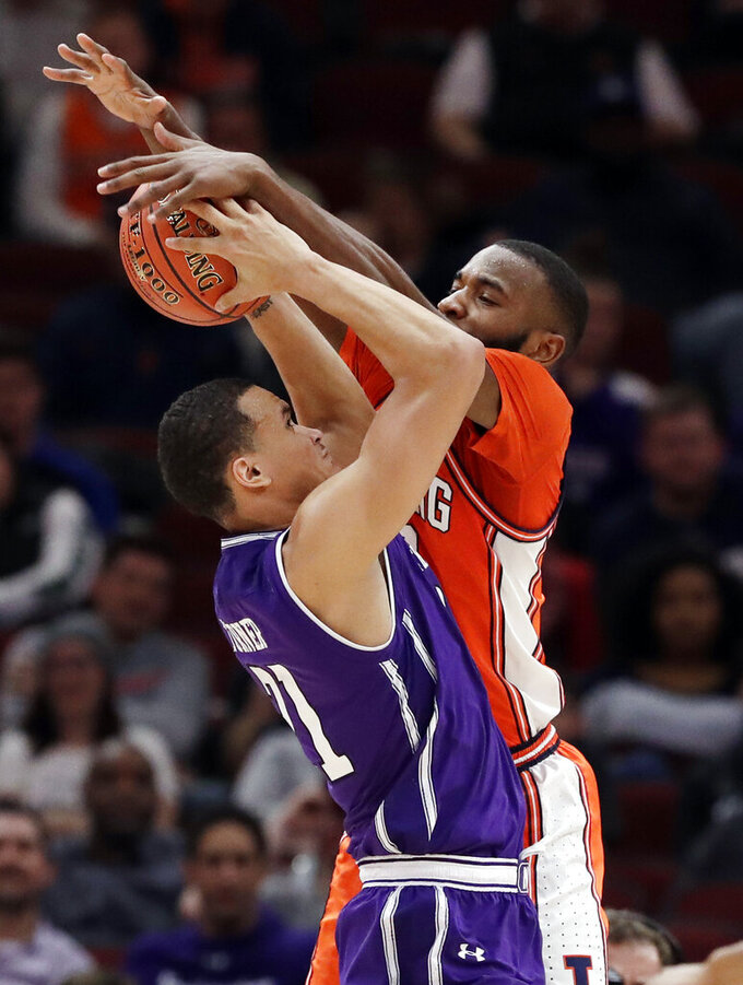 Illinois guard Aaron Jordan, right, blocks a shot by Northwestern forward A.J. Turner during the second half of an NCAA college basketball game in the first round of the Big Ten Conference tournament in Chicago, Wednesday, March 13, 2019. Illinois won 74-69 in overtime. (AP Photo/Nam Y. Huh)