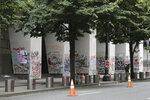 Graffiti from recent demonstrations covers pillars outside of the Mark O. Hatfield Federal Courthouse in downtown Portland, Ore., on Wednesday, July 8, 2020. Protesters who have clashed with authorities in Portland, Ore., are facing off not just against city police but a contingent of federal agents who reflect a new priority for the Department of Homeland Security: preventing what President Donald Trump calls
