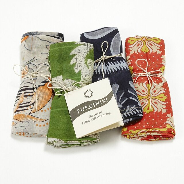 This undated product image provided by Ten Thousand Villages shows gift wrap made from saris that are recycled by artisans in Bangladesh. The company says sales have been growing steadily since the wraps were introduced in 2013; so far this year, sales are up 20% over 2018. (Ten Thousand Villages via AP)