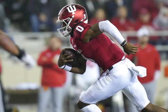 Indiana quarterback Donaven McCulley (0) runs with the ball while playing Ohio State during the first quarter of an NCAA college football game in Bloomington, Ind., Saturday, Oct. 23, 2021. (AP Photo/AJ Mast)