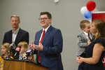 Surrounded by family, Jake LaTurner talks to the media after winning the Republican primary for Kansas' 2nd Congressional District, Tuesday, Aug. 4, 2020, in Topeka, Kan. (Evert Nelson/The Topeka Capital-Journal via AP)