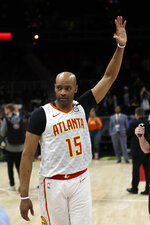 FILE - In this March 11, 2020, file photo, Atlanta Hawks guard Vince Carter (15) waves to the crowd as he leaves the court following an NBA basketball game against the New York Knicks, in Atlanta. Carter made his retirement official Thursday, June 25, 2020, announcing on his podcast that his 22-year NBA career has come to an end. The announcement was largely a formality, since the 43-year-old Carter had said many times over the course of this season that this would be his last in the NBA. His 22 seasons are the most in league history, and he became the first NBA player to appear in four different decades. (AP Photo/John Bazemore, File)