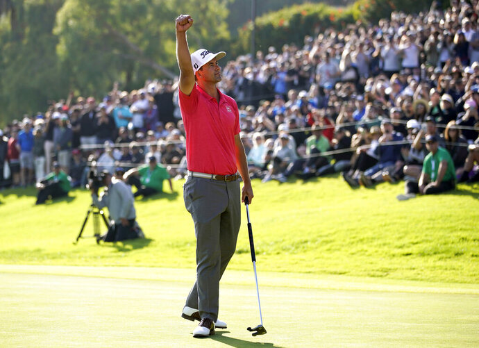 Adam Scott, of Australia, reacts after finishing the Genesis Invitational golf tournament at Riviera Country Club, Sunday, Feb. 16, 2020, in the Pacific Palisades area of Los Angeles. Scott won the tourney.(AP Photo/Ryan Kang)