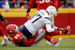 Kansas City Chiefs defensive end Terrell Suggs (94) sacks Los Angeles Chargers quarterback Philip Rivers (17) during the second half of an NFL football game in Kansas City, Mo., Sunday, Dec. 29, 2019. (AP Photo/Charlie Riedel)