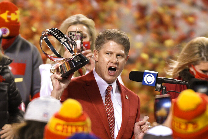 Kansas City Chiefs owner Clark Hunt celebrates with the Lamar Hunt Trophy after the AFC championship NFL football game against the Buffalo Bills, Sunday, Jan. 24, 2021, in Kansas City, Mo. The Chiefs won 38-24. (AP Photo/Reed Hoffmann)