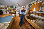 In this Oct. 7, 2020, photo is Victor Hermanson, a renowned saddle maker, in his workshop on the outskirts of Las Cruces, N.M. Customers seek out Hermanson for his 35 years of experience and his ability to fit the needs of competitive rodeo cowboys, ranchers and folks who want a high-end display piece. (Nathan J. Fish/The Las Cruces Sun News via AP)