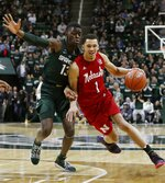 Nebraska guard Amir Harris (1) drives on Michigan State forward Gabe Brown (13) during the first half of an NCAA college basketball game, Tuesday, March 5, 2019, in East Lansing, Mich. (AP Photo/Carlos Osorio)