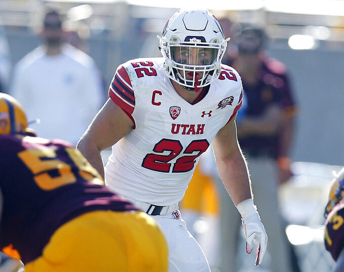 FILE - In this Nov 3, 2018, file photo, Utah linebacker Chase Hansen (22) looks over the line of scrimmage during an NCAA college football against Arizona State in Tempe, Ariz. Hansen has played an important role in getting the No. 17 Utes to their first Pac-12 championship came, where they will face No. 10 Washington on Friday night. (AP Photo/Rick Scuteri, File)