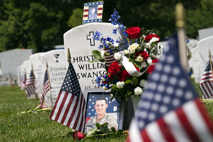 The headstone of Army Christopher William Swanson is seen at Arlington National Cemetery on Memorial Day in Arlington, Va., Monday, May 31, 2021. (AP Photo/Jose Luis Magana)